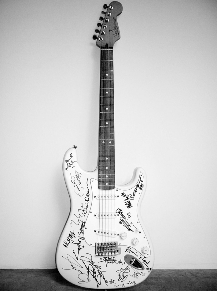 """A unique Fender Stratocaster Guitar came out as the most notable thing auctioned to raise money for the Reach Out to Asia charity."" World's Most Expensive Guitar: Fender Standard Series Stratocaster World's Most Expensive Guitar: Fender Standard Series Stratocaster 110"