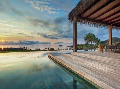 Exclusive Destinations: Eco-Chic Luxury Fiji Hotels fiji hotels Exclusive Destinations: Eco-Chic Luxury Fiji Hotels 01 Sunset over Residence pool 7181 ORIGINAL 420x311